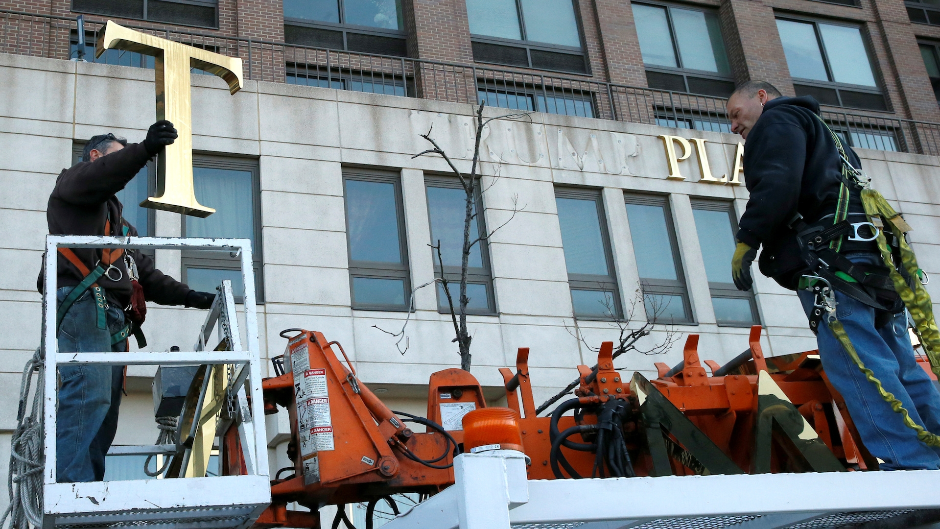 For the second time in two days, a building called Trump Place decides to take down the president's name