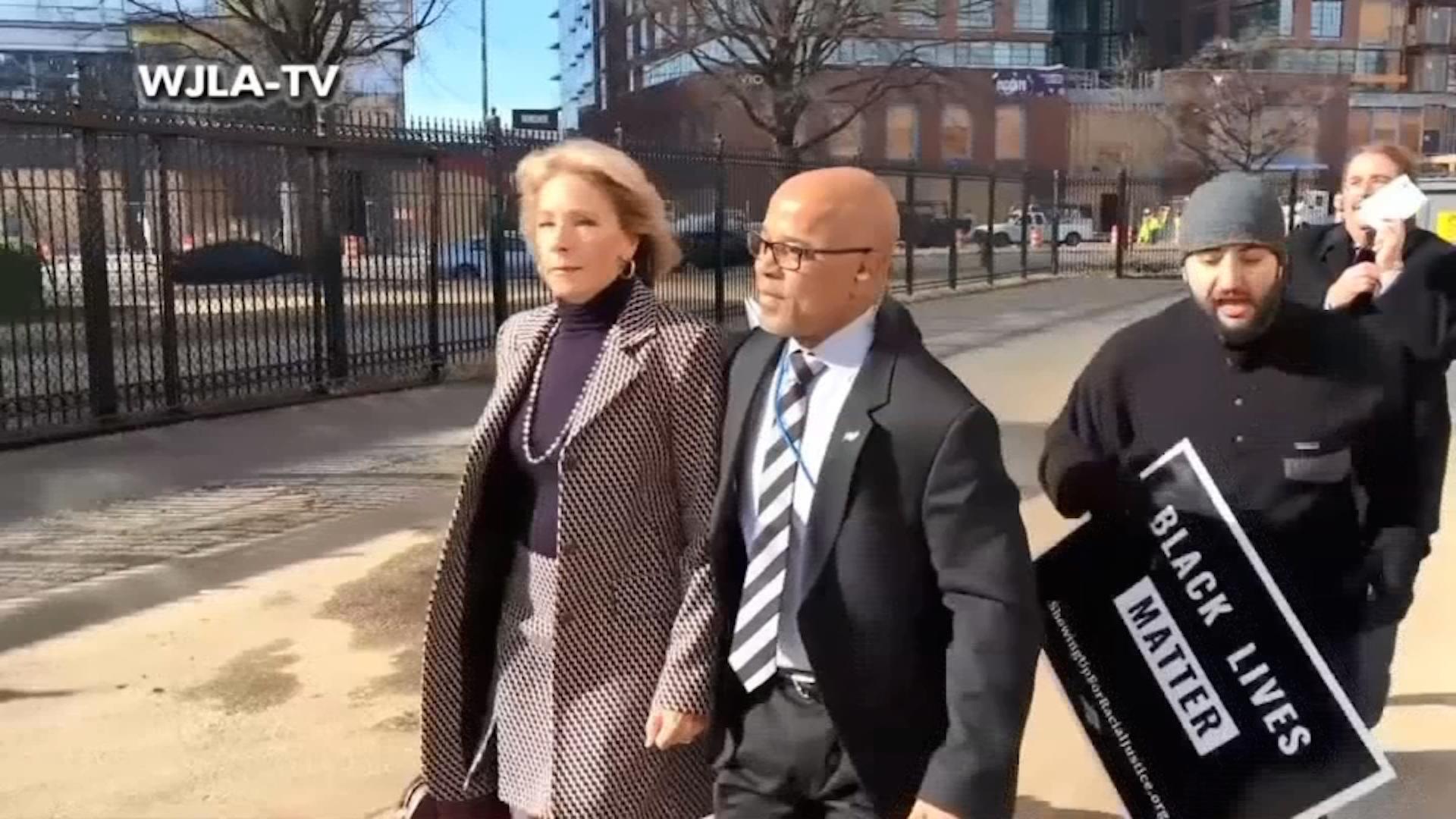 Protesters briefly block Education Secretary Betsy DeVos's visit to a D.C. school