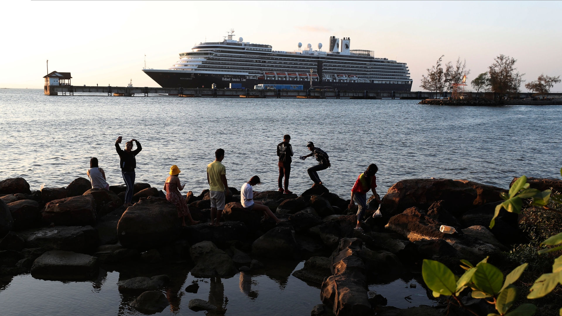 Photos show passengers finally disembark cruise ship that was stranded at sea over coronavirus fears