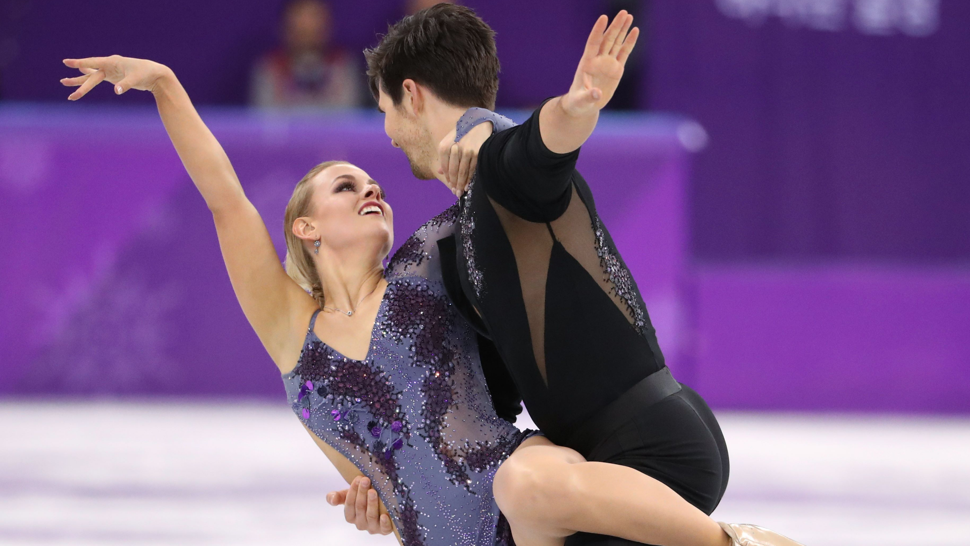 How is figure skating scored?