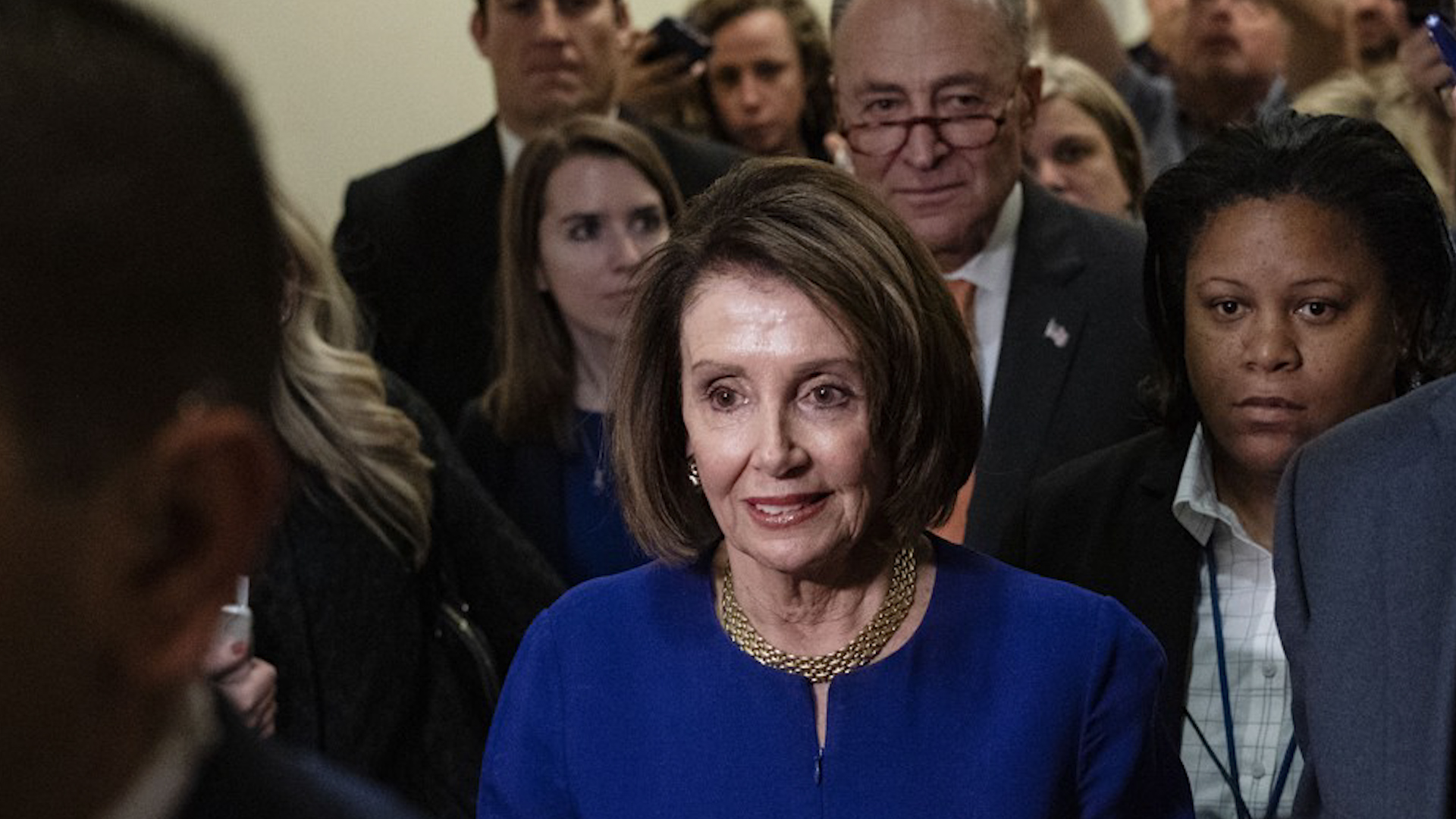 Outside Washington, Pelosi neither says nor hears much about Trump or impeachment