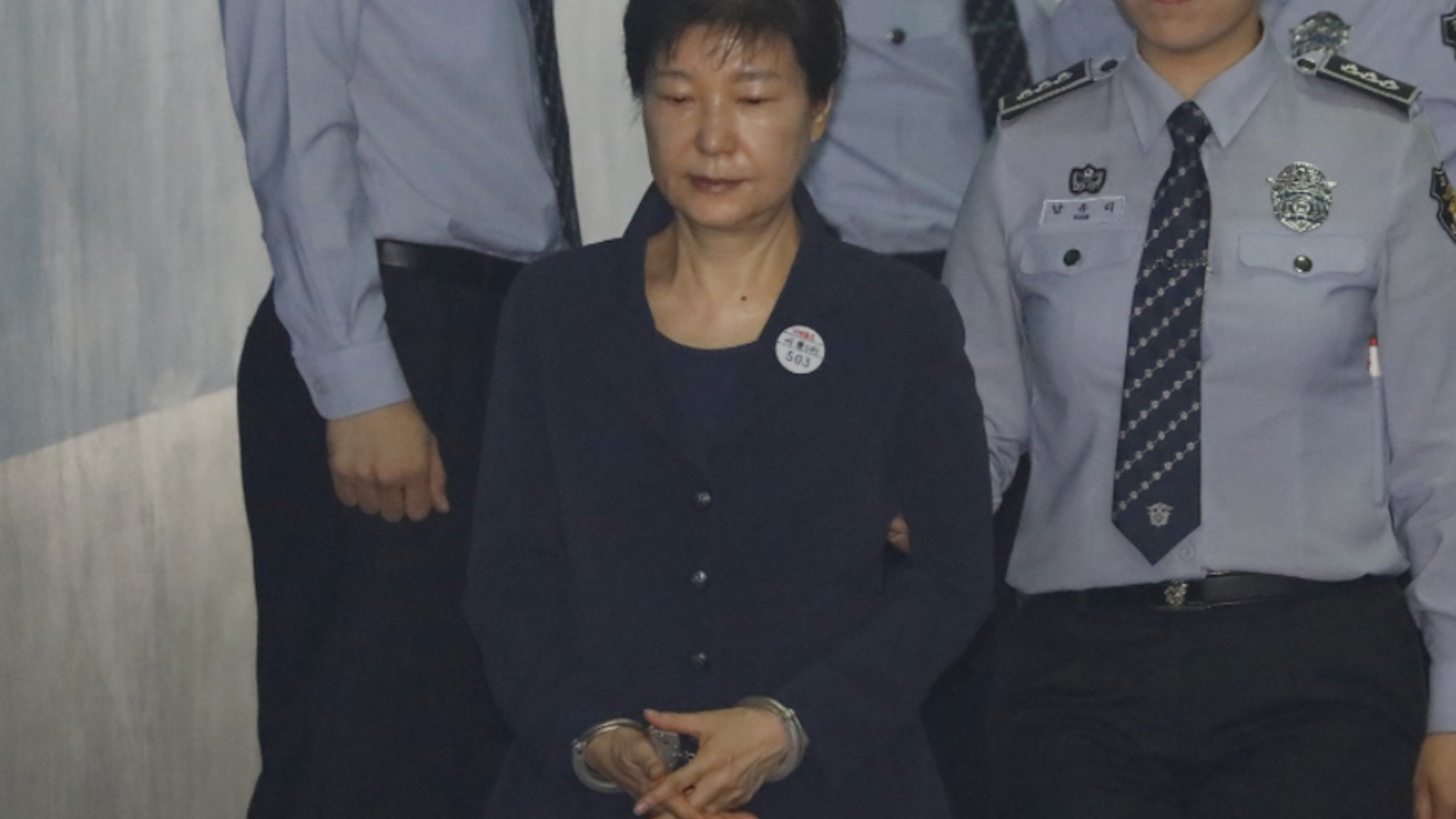 South Koreans get a glimpse of their ousted president — in handcuffs