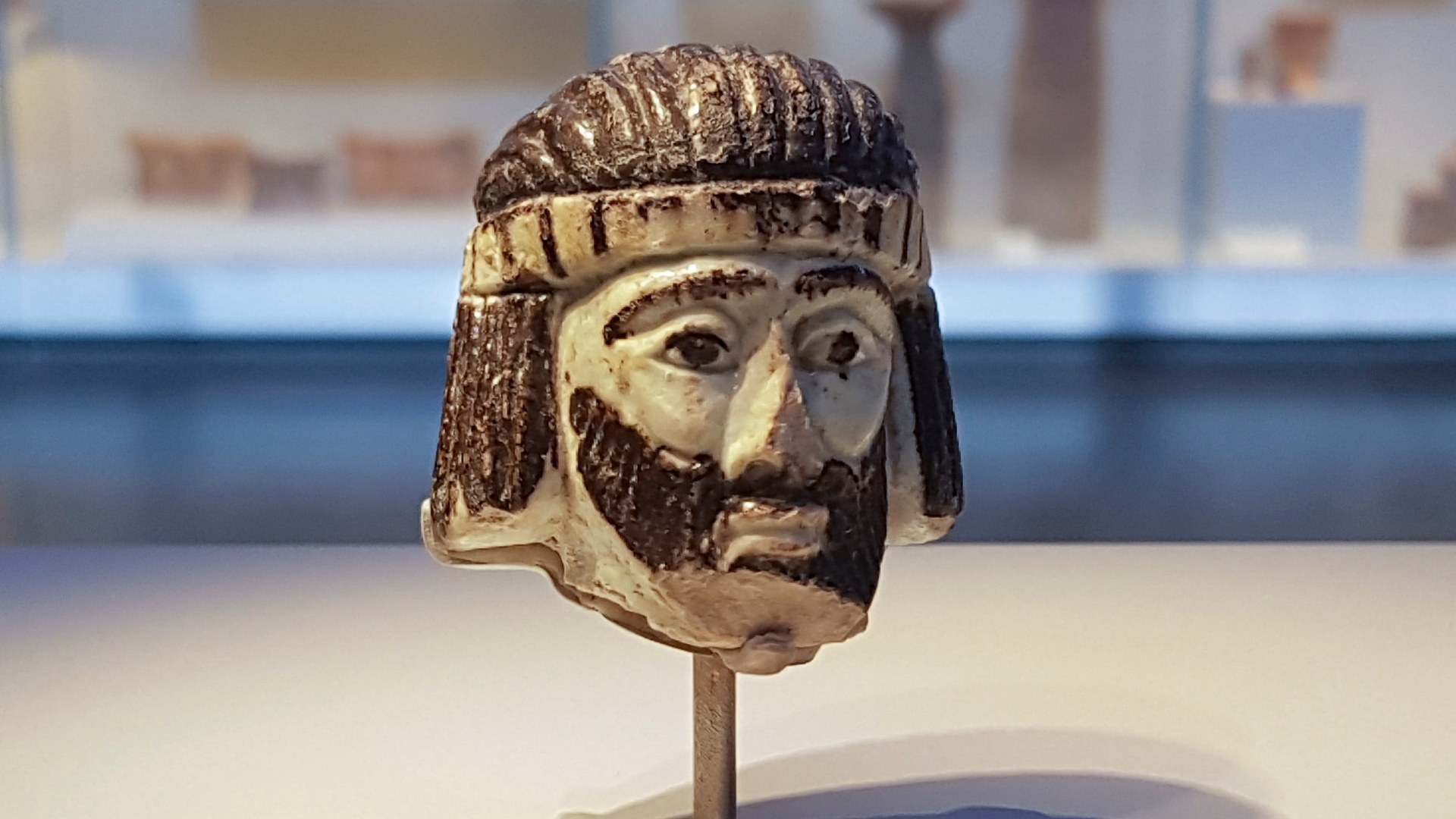 A 3,000-year-old glass head deepens one of the Bible's oldest mysteries