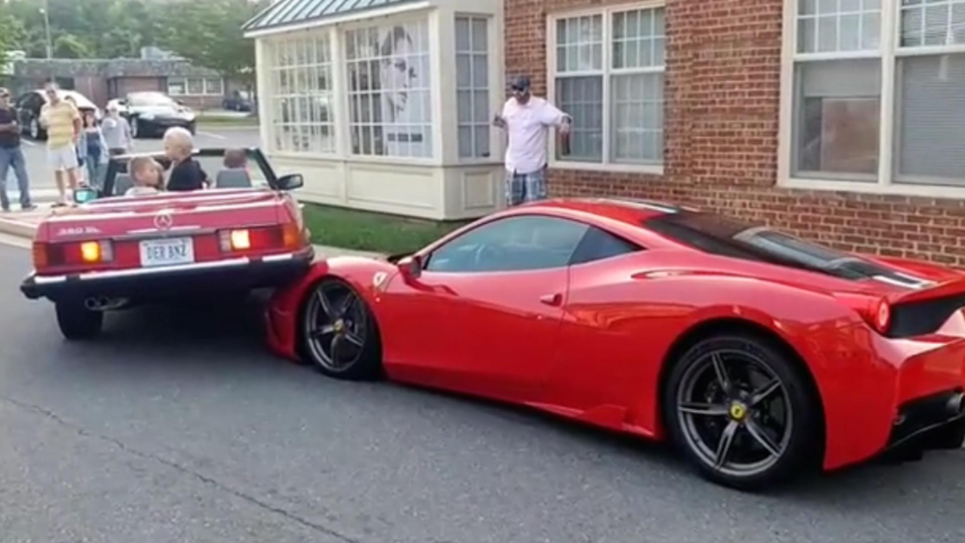 Ferrari Owner Watches In Horror As Mercedes Mounts His Hood