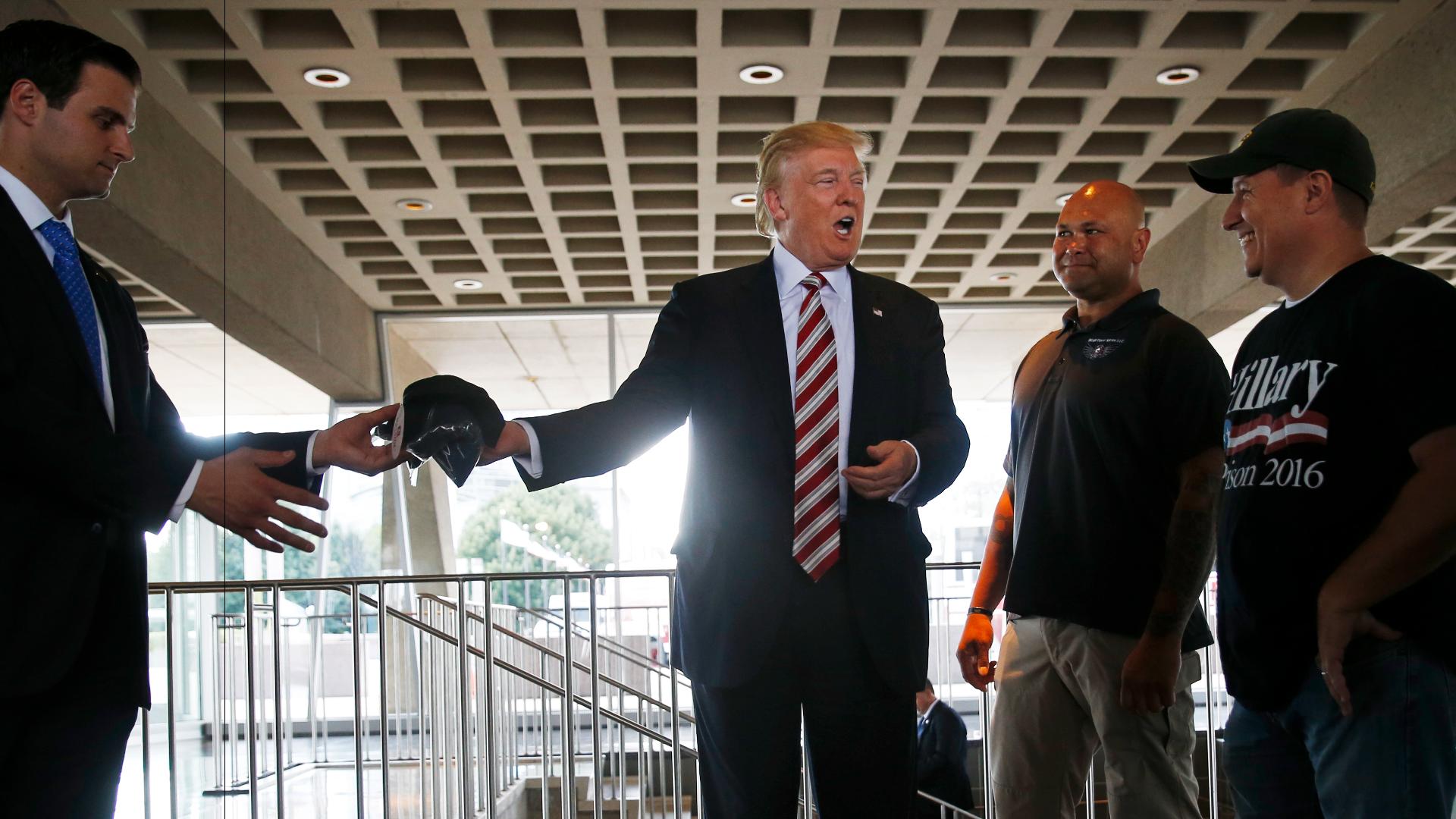 Trump shakes up campaign, demotes top adviser