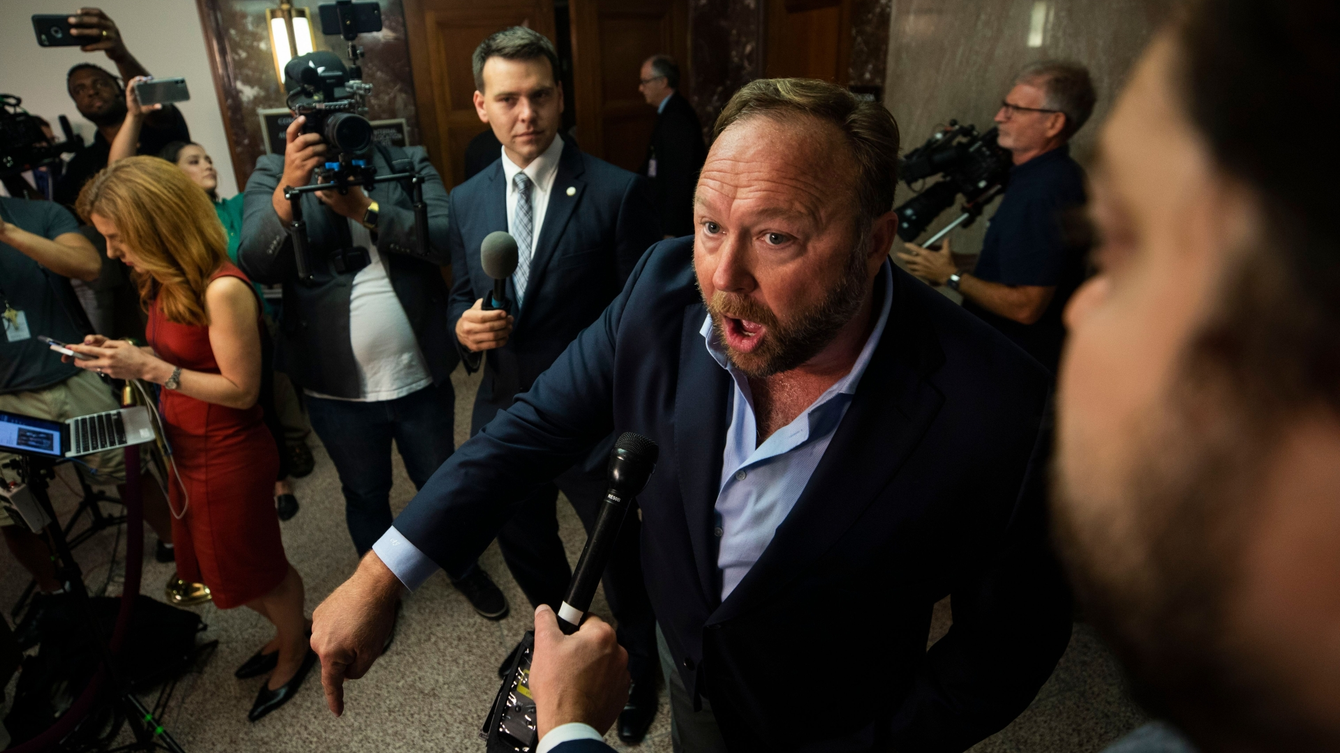 Alex Jones banned from Facebook? His videos are still there — and so are his followers