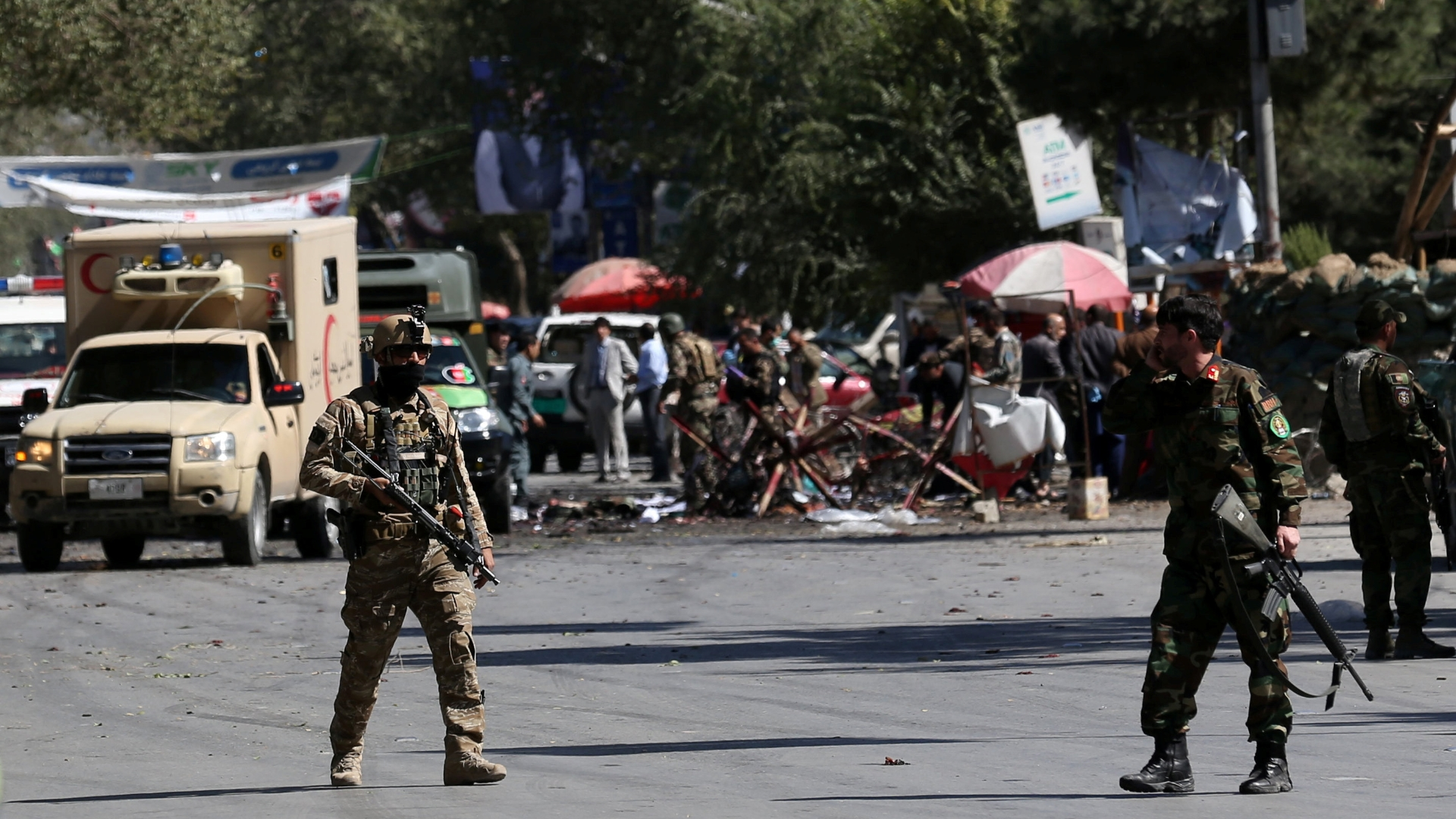 Taliban suicide bombers strike Kabul and rally for Afghan president, killing at least 48