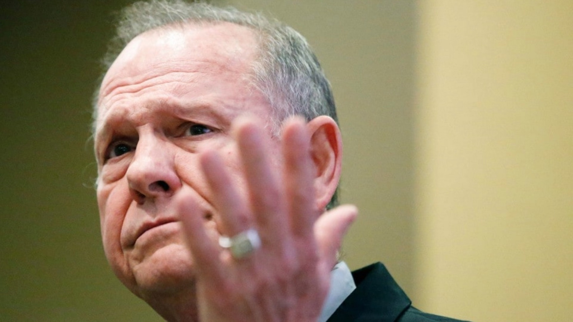 Woman says Roy Moore initiated sexual encounter when she was 14, he was 32