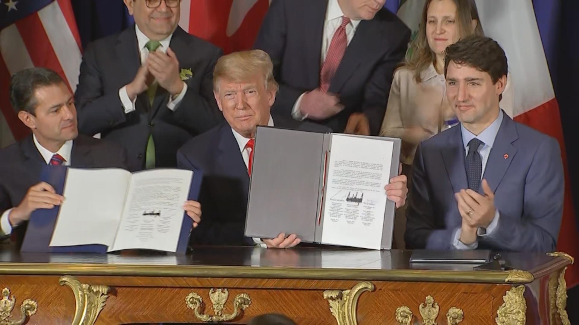 After signing new North American trade pact at G-20, Trump turns sights to China