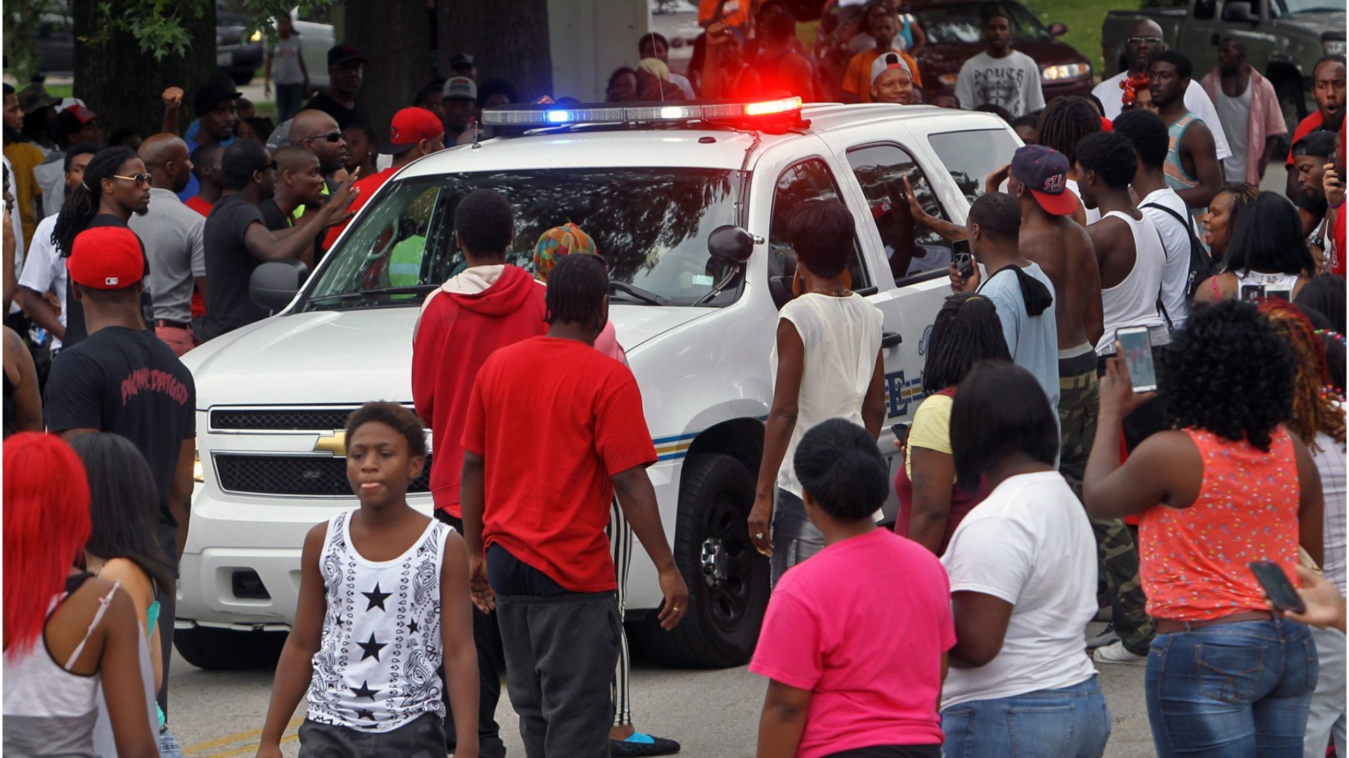 In three minutes, two lives collide and a nation divides over Ferguson shooting