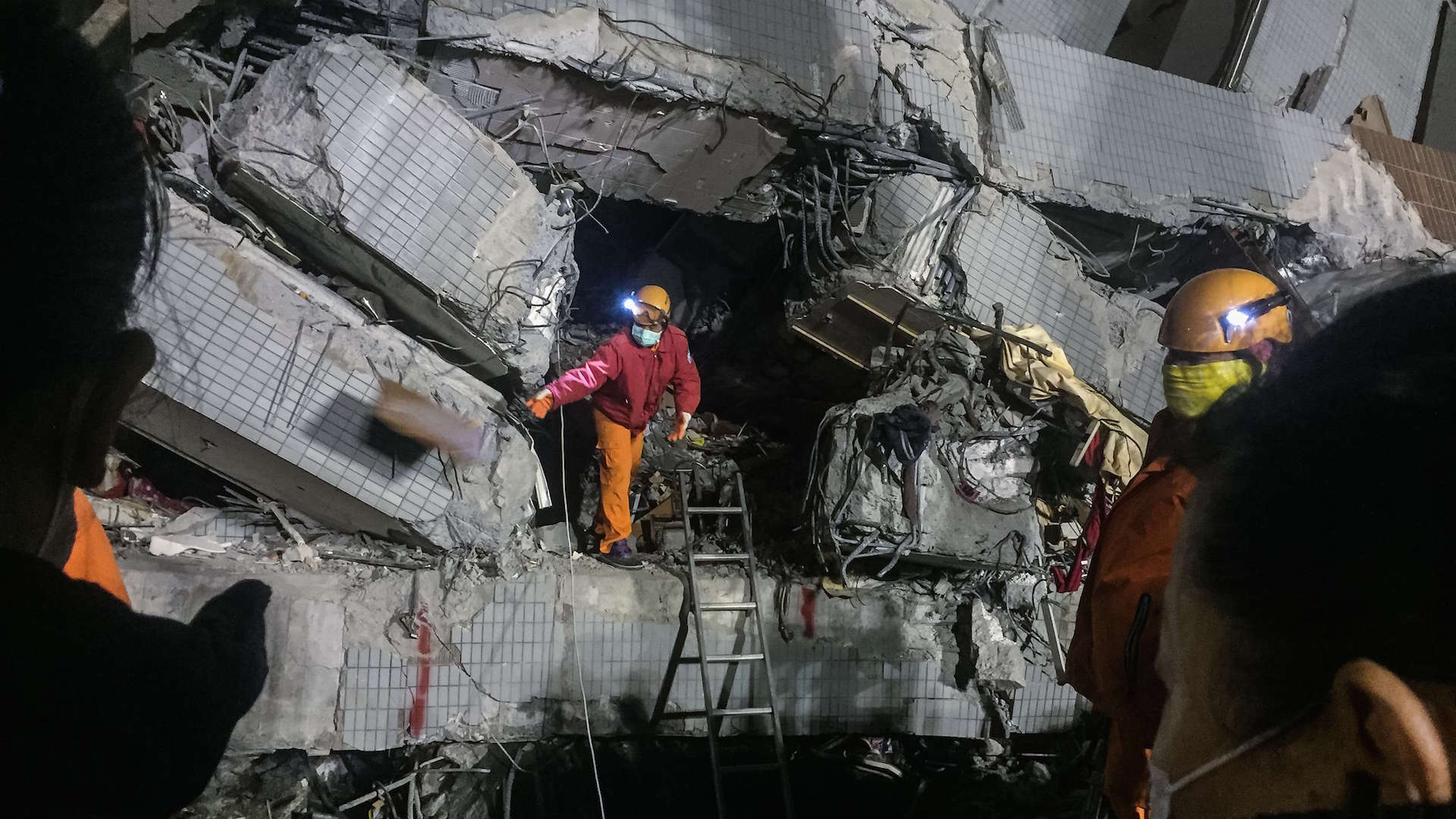 With dozens dead, Taiwan has questions and an arrest warrant for developer of building that fell in quake