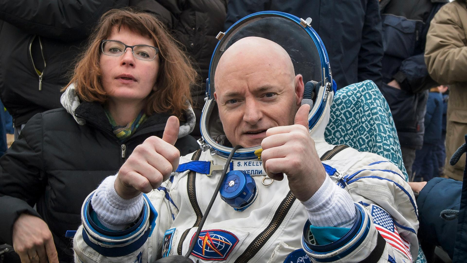 'Touchdown!' Scott Kelly returns to Earth with a fist-pump and a cult following.